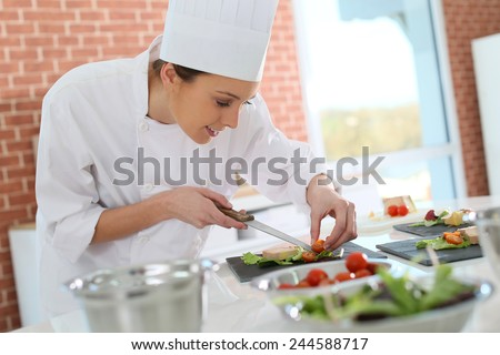 Smiling cook preparing appetizer - stock photo