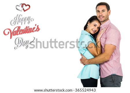 Smiling couple hugging and looking at camera against cute valentines message - stock photo
