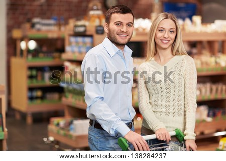 Smiling couple in the store - stock photo