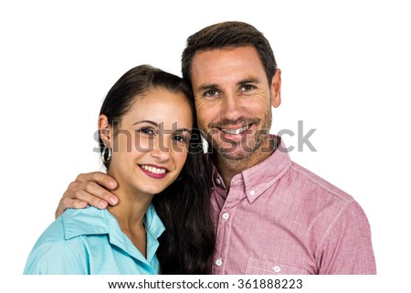 Smiling couple looking at camera on white screen - stock photo