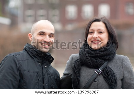 Smiling couple looking very happy - stock photo