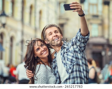 Smiling couple making selfie - stock photo