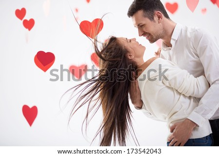 Smiling couple on a white background - stock photo