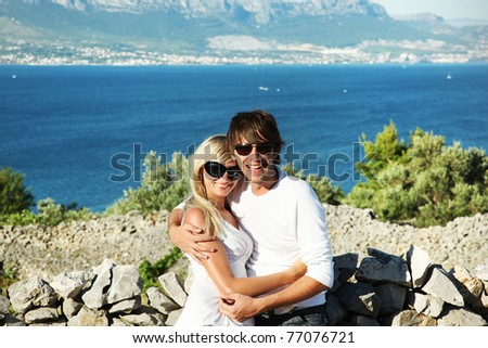 Smiling couple on vacation - stock photo
