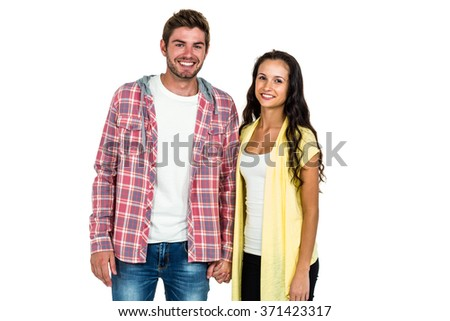 Smiling couple standing and looking at camera on white screen - stock photo