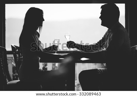 Smiling couple with champagne in a restaurant - stock photo