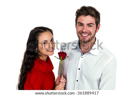 Smiling couple with rose on white screen - stock photo