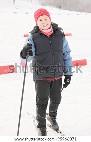 Smiling cross-country skier in winter day - stock photo