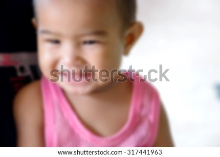 smiling cute baby ,blurry background - stock photo