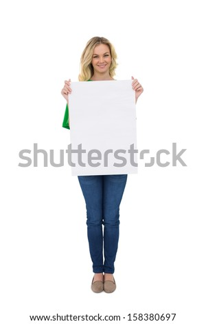 Smiling cute blonde holding white sign on white background - stock photo