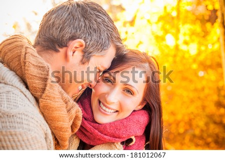 smiling cute couple in sundown sun - stock photo