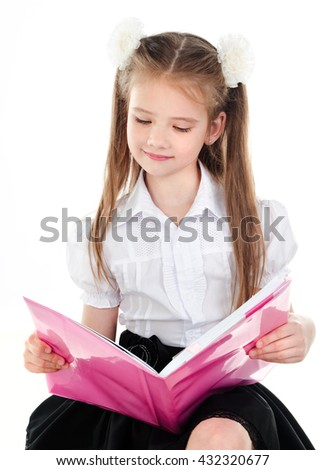 Smiling cute schoolgirl reading the book isolated on a white background - stock photo