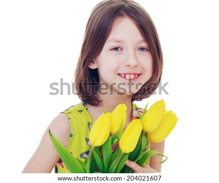 Smiling dark-haired girl with a bouquet of yellow tulips.Happiness concept,happy childhood - stock photo