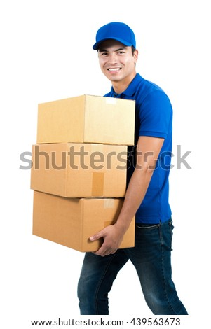 Smiling delivery man holding boxes - isolated on white background - stock photo