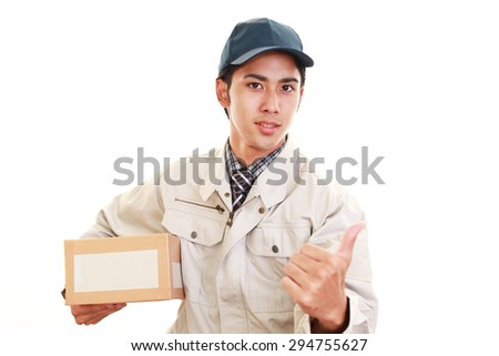 Smiling delivery man isolated on white background - stock photo