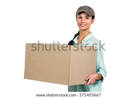 Smiling delivery woman holding pack on white background - stock photo