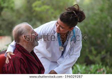 smiling Doctor caring for patient - stock photo