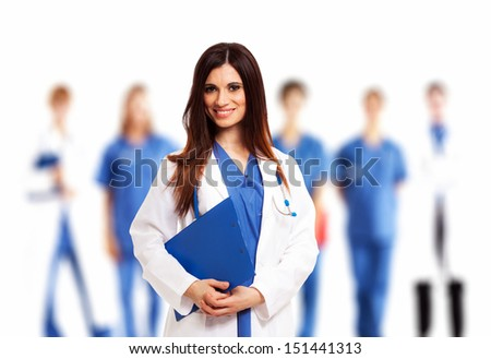 Smiling doctor in front of her medical team - stock photo