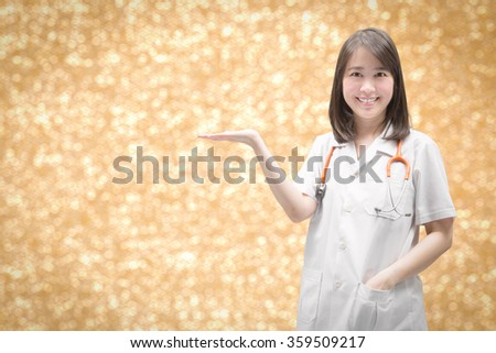 smiling doctor with hand palm presenting on gold glitter background - stock photo