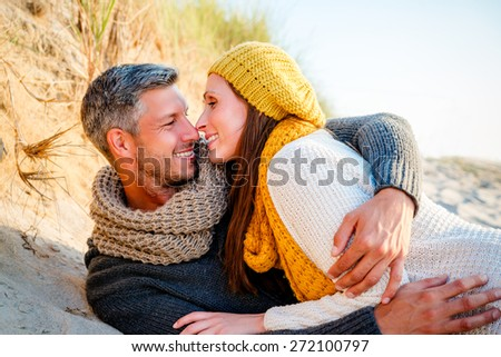 smiling embracing funny loved girlfriend with boyfriend - stock photo
