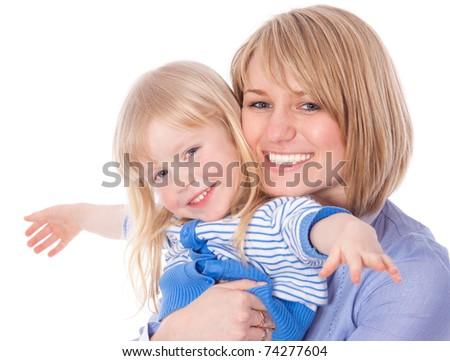 Smiling embracing mom and daughter looking at camera - stock photo