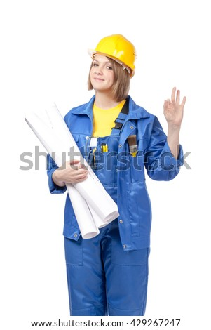 smiling engineer or architect female in yellow helmet and blue workwear with blueprints showing an okay sign isolated on white background. proposing service. advertisement gesture - stock photo
