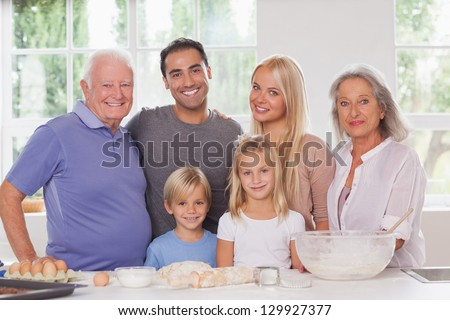 Smiling extended family baking portrait - stock photo