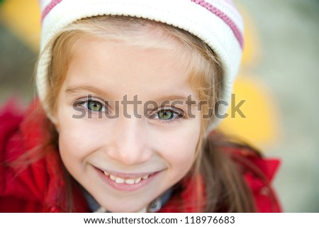 Smiling face of little girl closeup - stock photo