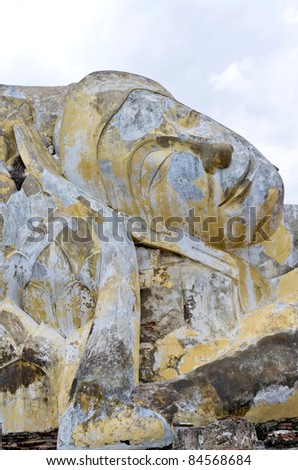 Smiling face of reclining buddha in Ayutthaya historical park, T - stock photo