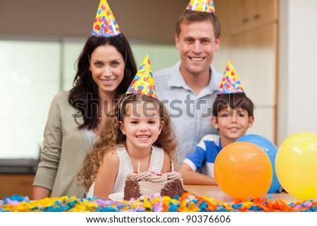 Smiling family celebrating birthday together - stock photo
