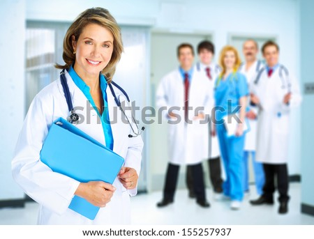 Smiling family doctor woman with stethoscope. Health care. - stock photo