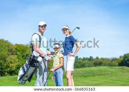 Smiling family on the golf course - stock photo