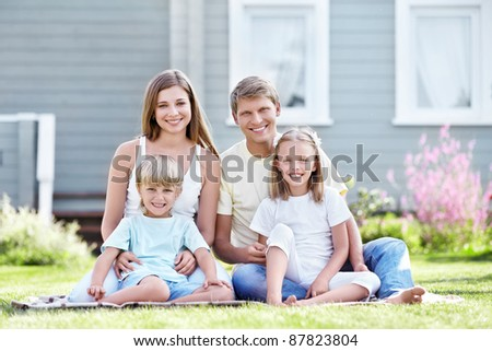 Smiling family with children in the garden - stock photo