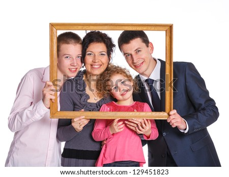 Smiling family with two kids looking through an frame. Isolated white background. - stock photo