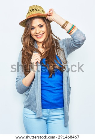 Smiling fashion model posing against white background. Beautiful young woman in street style dressed. - stock photo