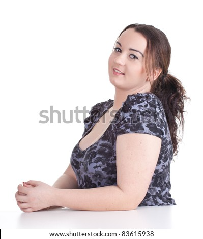 smiling fat beautiful young woman in dark dress - stock photo