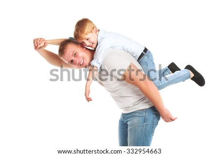 Smiling father playing with his son flying isolated - stock photo