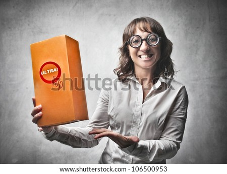 Smiling female announcer advertising a product - stock photo