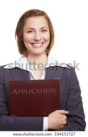 Smiling female applicant holding application folder in her hands - stock photo