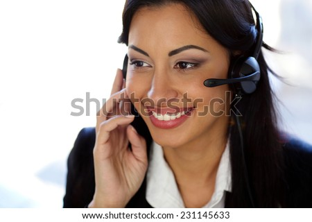 Smiling female customer support operator with headset - stock photo