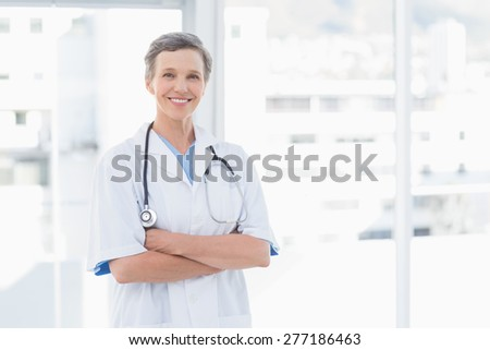 Smiling female doctor in medical office - stock photo