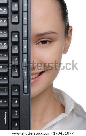 Smiling female face covered keyboard isolated on white - stock photo