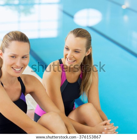 Smiling female fitness in swimming pool  - stock photo
