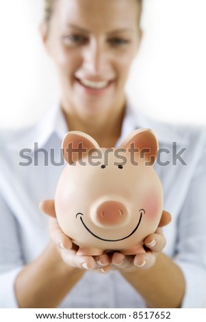 smiling female holding piggy-bank - stock photo