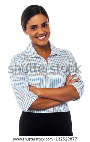 Smiling female manager posing with confidence, arms crossed. - stock photo