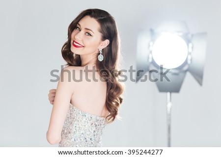 Smiling female model posing in fashion dress  - stock photo