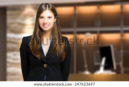 Smiling female receptionist - stock photo