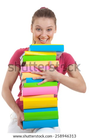 Smiling Female Student Carrying a lot of Colorful Books on the White Background - stock photo