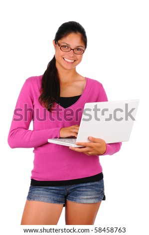 Smiling female teenage student with long brown hair holding a laptop computer. Brunette girl wearing eye glasses in vertical format isolated on white. - stock photo