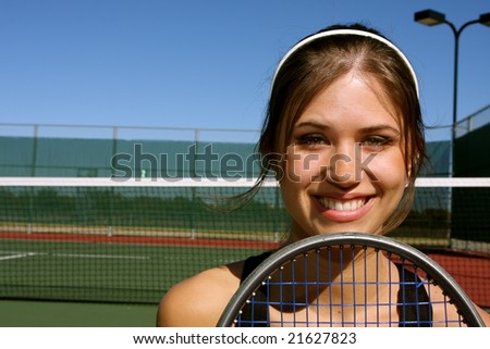 Smiling Female Tennis player with room for copy - stock photo